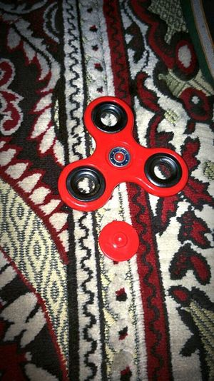 Red Multi Colored Backgrounds Full Frame Art And Craft Pattern Textile Close-up Indoors  No People Textured  Day Got My Spinner Fidget Fidget Spinner Fidget Toy Fidgets Fidgeting Adult Toy Be Impressed Love To Take Photos ❤ My Baby Love This One Lol My Love Timepass