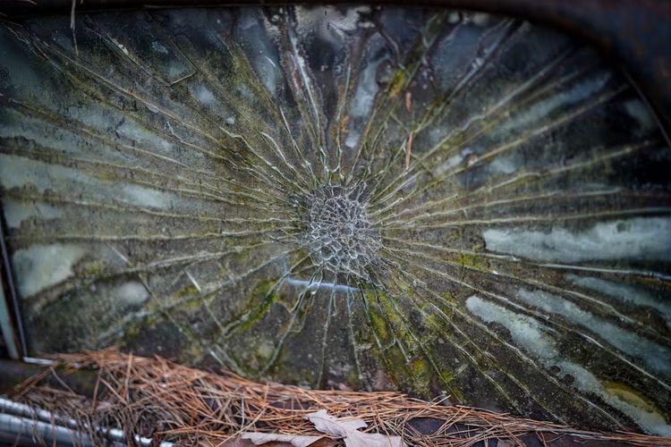 Close-up of broken glass window