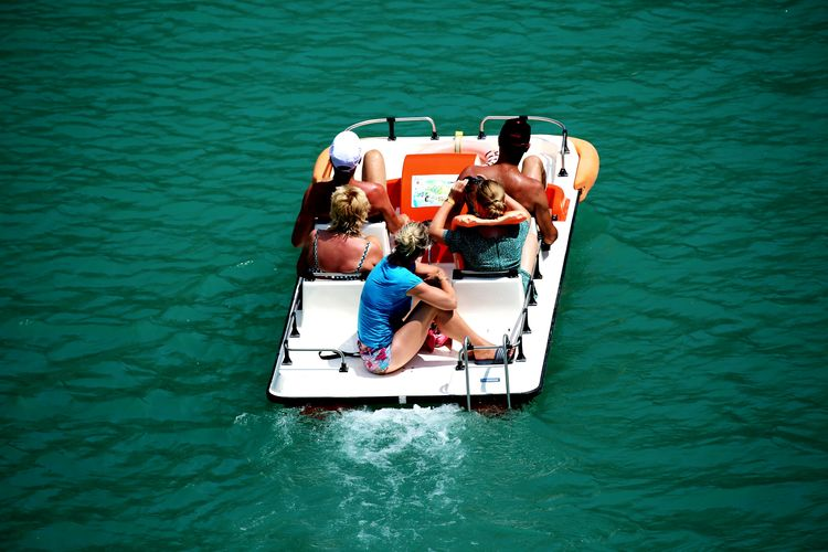 High Angle View Of Friends On Pedal Boat In River