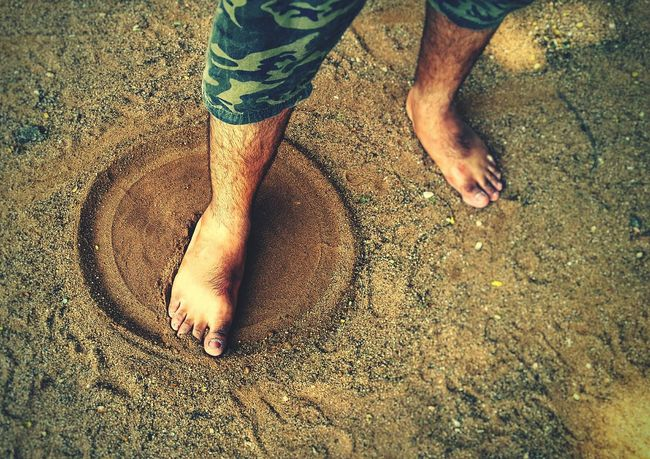 Childhood fun in sand... Sand Sandy Beach Sand Art Sandy Feet Feet Circle CIRCLE Of LIFE Circle In Sand Circular Hairy Legs  Sand Grains Playing In The Sand Childhood Memories Childhood Q Photography In Motion First Eyeem Photo BYOPaper! Press For Progress This Is Masculinity