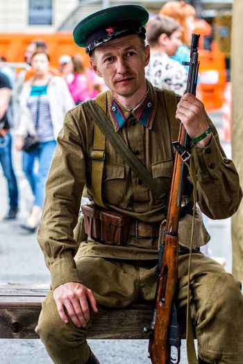 Portrait of soldier sitting outdoors