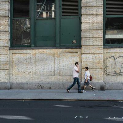 Two men walking on the SidewalkAcross Streetphotography 50mm Urban NYC 19thstreet