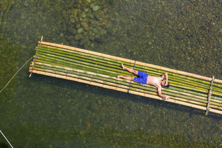 Outdoors Childhood Leisure Activity Relaxation Lying Down Bench Water People High Angle View Full Length Real People Lifestyles Plant Day Nature Men Child Sitting