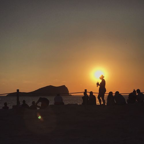 Sunset watchers Silhouette Sunset Sun Water Sea Togetherness Horizon Over Water Beach Friendship Men Standing Orange Color Person Lifestyles Sunlight Tranquil Scene Scenics Vacations Tranquility Enjoyment IPhone7Plus IPhoneography