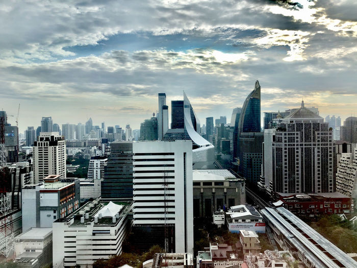 Bangkok city view with clouds Built Structure Architecture Building Exterior City Sky Cityscape Building Office Building Exterior Cloud - Sky Skyscraper Tall - High Modern Crowd Crowded Nature Office Urban Skyline Tower Financial District  Outdoors Spire  Settlement