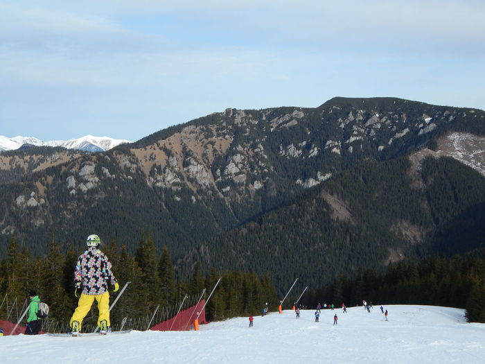JASNA, SLOVAKIA - JANUARY 10, 2014. Ski resort and people. Snow Winter Cold Temperature Real People Lifestyles Outdoors