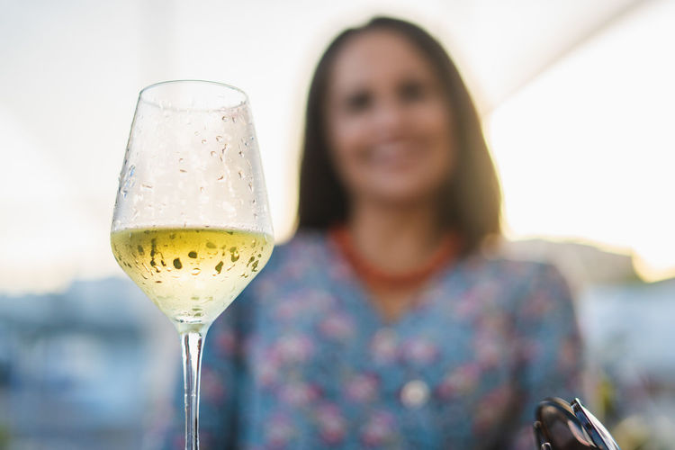 Low angle view of woman having wine in glass at restaurant