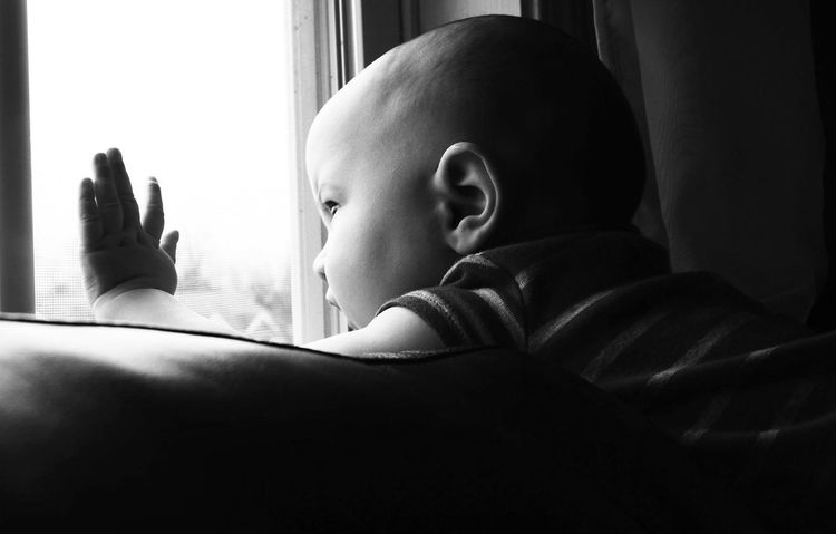 He loves to sit and look out the window. Black And White Baby Enjoying Life People