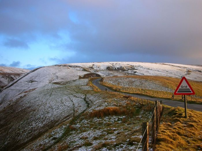 Snowy welsh mountain road home Outdoors No People Landscape Nature Day Snow Hills Hillclimb Cyclephotography Cyclesnow Tranquility Rural Scene Cattle Grid Offgrid Darkcloud Winterscapes Winter Winter Landscape Evening Glow
