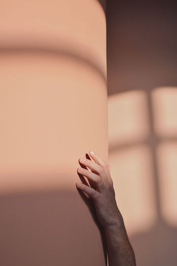 Close-up of woman hand on wall