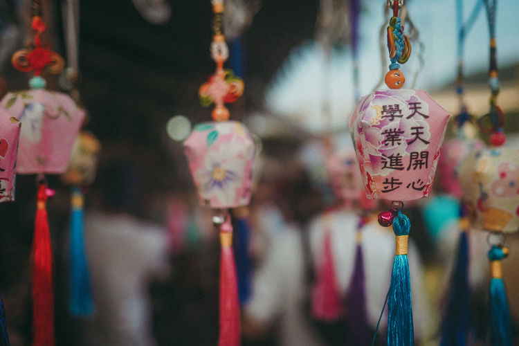 Colorful souvenirs EyeEmNewHere Bokeh Photography Souvenir Colorful Taiwan Charms Multi Colored Hanging Full Frame Market Text Retail  For Sale Close-up