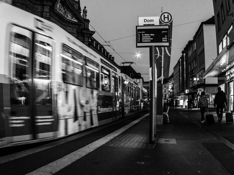 "Next stop: Rathaus–Tram leaving the stop ""Dom"". Learn & Shoot: After Dark Tram Würzburg Tram Stop Public Transportation"