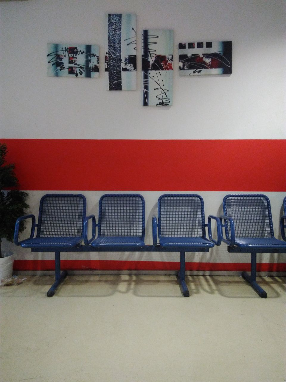 chair, in a row, table, indoors, empty, red, no people, seat, architecture, furniture, day, film industry