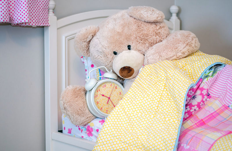 Is it time to get up yet? this giant teddy bear checks the alarm clock to see what time it is Fun Pink Alarm Clock Bed Checking The Time Childhood Clothing Comical Day Domestic Room Focus On Foreground Furniture Home Interior Human Representation Indoors  Life Size  Pink Color Representation Softness Still Life Stuffed Toy Teddy Bear Textile Toy Yellow The Creative - 2018 EyeEm Awards The Still Life Photographer - 2018 EyeEm Awards