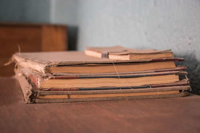 Throw the book at 'em! Book Close-up Day Indoors  No People Selective Focus Stack Still Life Table Tied Up Wood - Material The Still Life Photographer - 2018 EyeEm Awards