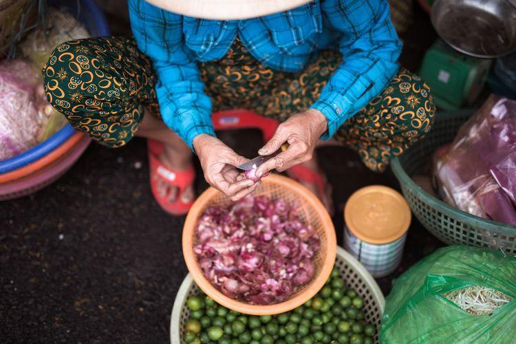 High angle view of woman having food at market
