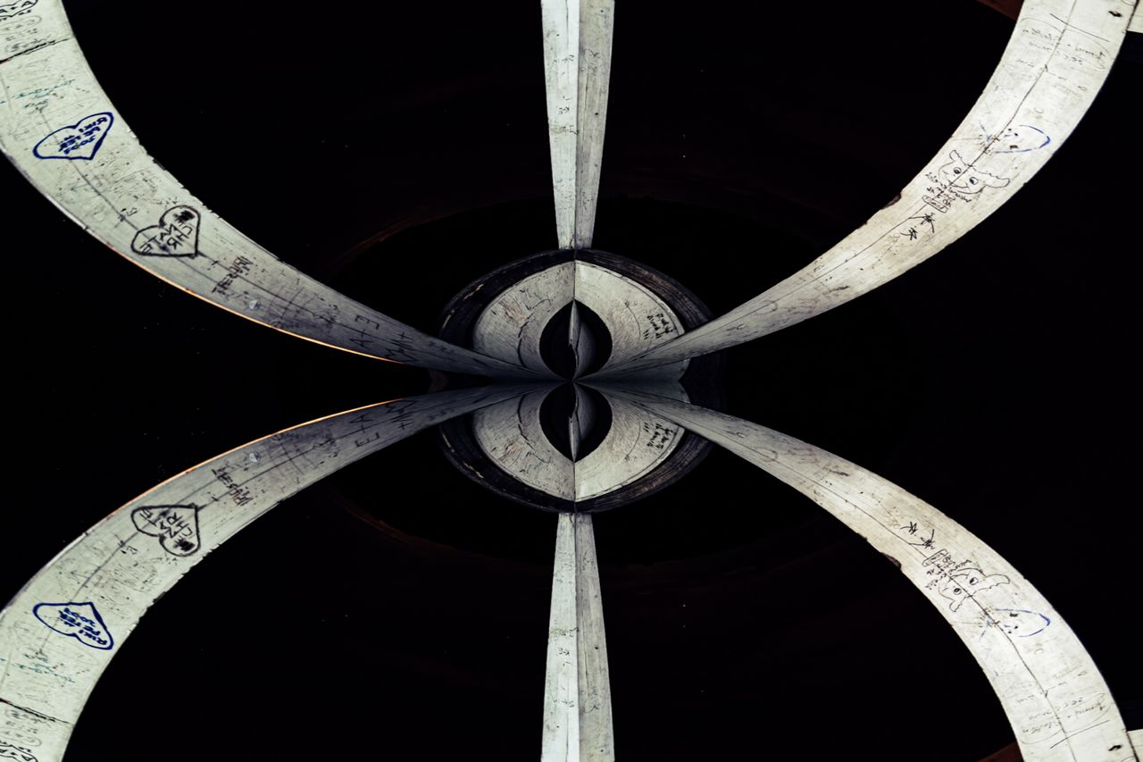pattern, no people, indoors, close-up, shape, geometric shape, circle, design, backgrounds, low angle view, directly below, number, architecture, black background, built structure, metal, day, full frame, still life, ceiling