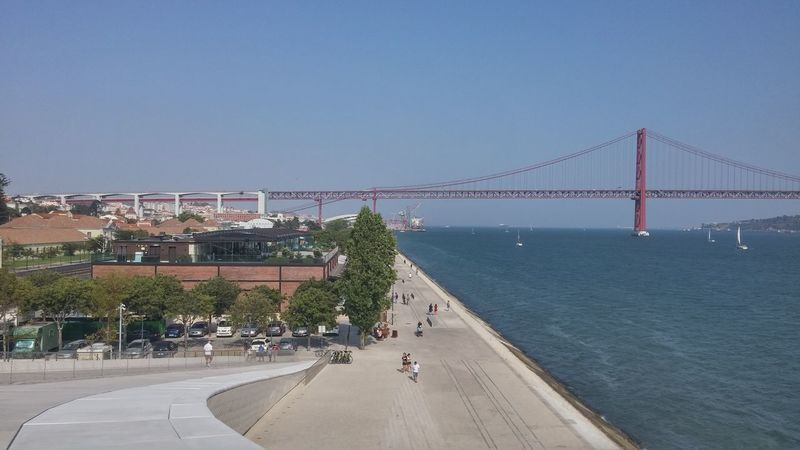 Walk in Front of MAAT Rio Tejo Tagus River MAAT Museum Ponte 25 De Abril Bridge River River Front Water Clear Sky Urban Skyline Bridge - Man Made Structure Sky