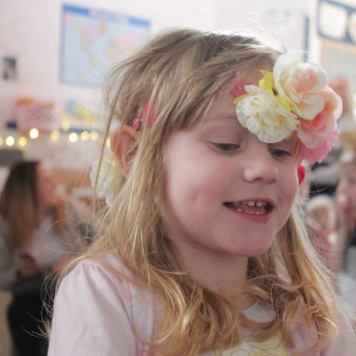 Close-Up Of Smiling Girl Wearing Flowers