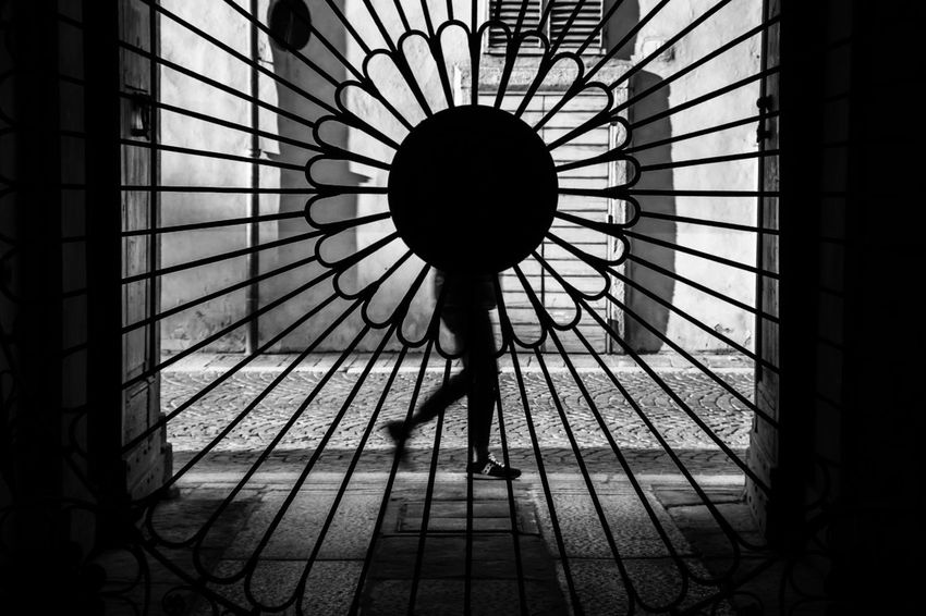 EyeEm Best Shots Silhouette Indoors  Real People One Person Standing Lifestyles Pattern Architecture Day Women Built Structure Full Length Men Leisure Activity Adult Rear View Metal Ceiling Shadow
