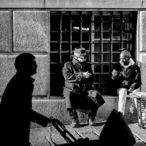 Speaking Blackandwhite Speaking Noracism Real People Sitting Shadow Building Exterior The Street Photographer - 2018 EyeEm Awards People Men Lifestyles Adult Outdoors Two People