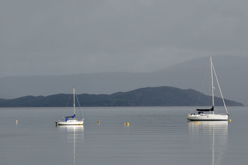 Yachts moored in calm waters at Broadford, Isle of Skye Boat Broadford Calm Cloud - Sky Highlands Mast Misty Mountain Mountain Range Nautical Vessel No People Non-urban Scene Sailing Scotland Sky Skye Tranquil Scene Tranquility Transportation Water Weather Yacht Yachts