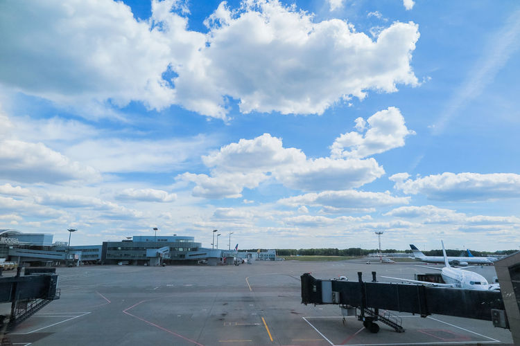 Runway and aircraft at the airport Cloud - Sky Sky Airport Transportation Airplane Airport Runway Mode Of Transportation Air Vehicle Nature Travel Day No People Public Transportation Road Outdoors Commercial Airplane Passenger Boarding Bridge Aerospace Industry Sunlight Runway Arrival