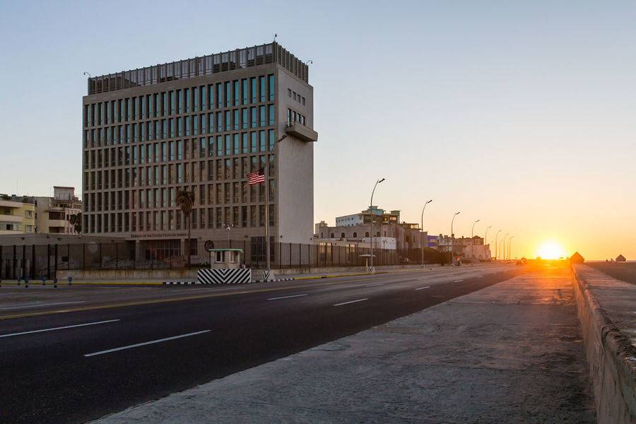 America in front of sunset at Cuba America American Embassy Architecture Building Exterior Cuba Embassy Malecon Ocean Outdoors Road Street Sunbeam Sunset Tall - High The Way Forward