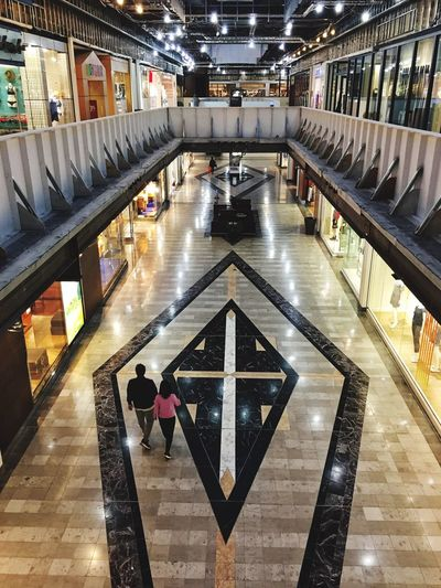 High Angle View Real People Women Illuminated Indoors  Lifestyles Men Architecture Leisure Activity Built Structure Full Length Standing Large Group Of People Day Futuristic Adult People Adults Only Interesting Perspective  Architecture Shopping Mall,