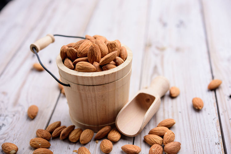 Food And Drink Food Still Life Wood - Material Nut - Food Indoors  Table Nut Freshness Bowl Large Group Of Objects Kitchen Utensil Wellbeing Close-up Almond No People Brown Focus On Foreground Ingredient Spoon Snack