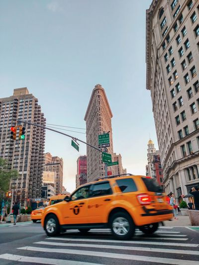 Flatiron Building Architecture Cityscape City Street NYC New York New York City Photos NYC Photography NYC Street Photography Street Road Skyline Midtown Historical Building Tourist Attraction  City Yellow Taxi Skyscraper Car Speed City Life Taxi Blurred Motion Sky Traffic City Street Avenue Rush Hour Zebra Crossing Crosswalk
