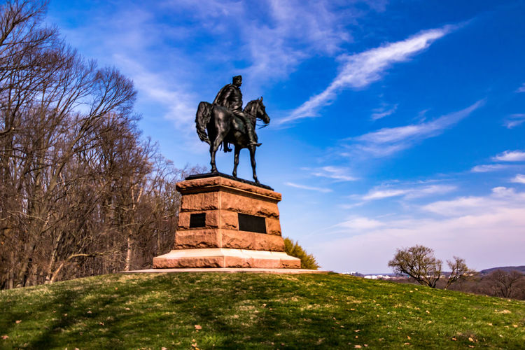 majestic statue against majestic sky Animal Representation Architecture Art Art And Craft Building Exterior Built Structure Cloud - Sky Creativity Famous Place Grass History Human Representation Low Angle View Sculpture Sky Statue Travel Destinations Tree Valley Forge National Park