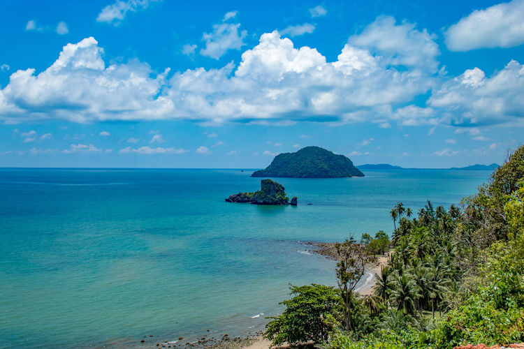 The beauty of the islands in the sea and sky at Sairee Sawee Beach , Chumphon Thailand. Sea Sky Water Cloud - Sky Scenics - Nature Beauty In Nature Horizon Over Water Horizon Tranquil Scene Tranquility Land Blue Nature Day Idyllic Beach No People Plant Outdoors Turquoise Colored Height Seascape Coastal Feature Coast Seashore Coastline Rocky Coastline Growing Reef Glacial