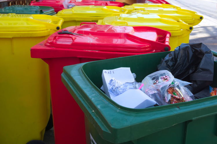 Multi-colored bins were put together by the road waiting for a car to take the garbage disposal. Clean Close-up Colorful Disposal Environment Environmental Garbage Garbage Bin No People Tash