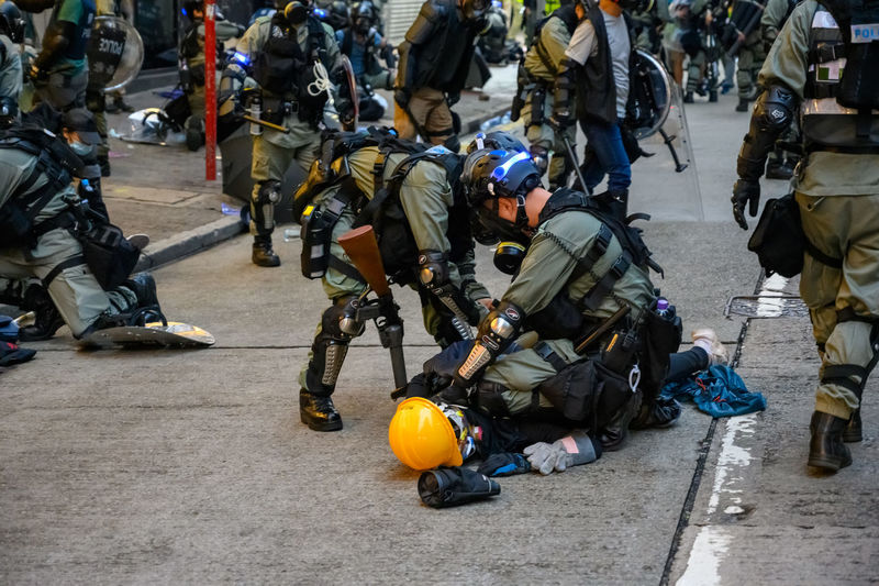 Protester getting arrest by police during protest