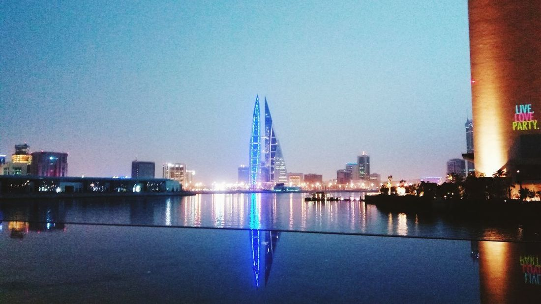 Reflection City Travel Destinations Night Urban Skyline Architecture Water Building Exterior Waterfront Modern Cityscape Sea Bahrain Bahrain Tourism Manama Bahrain Bay