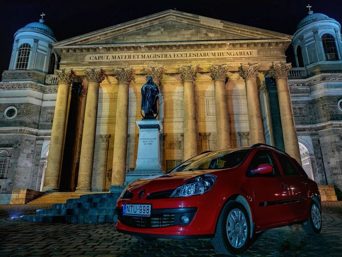 Night EyeEmNewHere Car Red Basilica City Statue Architectural Column Religion History Spirituality Architecture Built Structure Car Point Of View Vehicle Parking Stationary