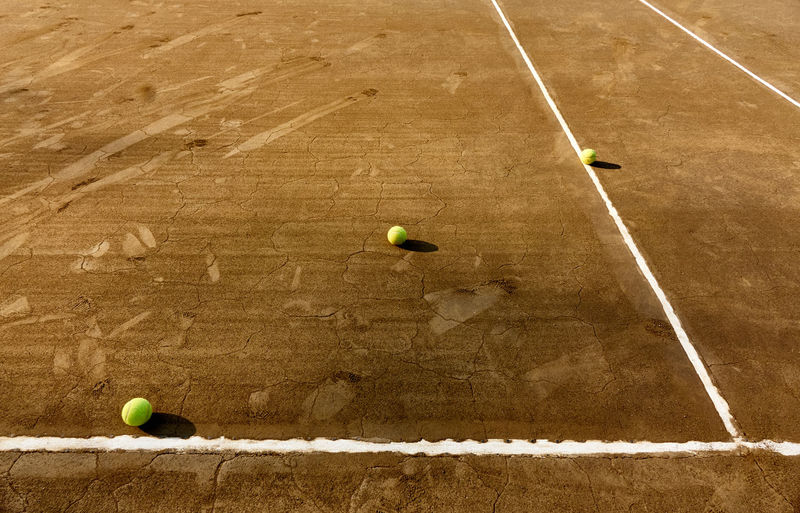 High angle view of balls on tennis court