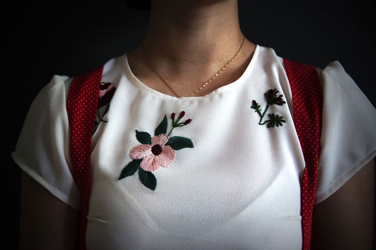 Argentina Midsection One Person Indoors  Lifestyles Casual Clothing Front View Close-up Red Flowering Plant Pattern Studio Shot T-shirt Real People Black Background Flower White Color Fashion Standing Adult Floral Pattern Embroidery Embroidered Fashion Fashion Photography Fashion Stories