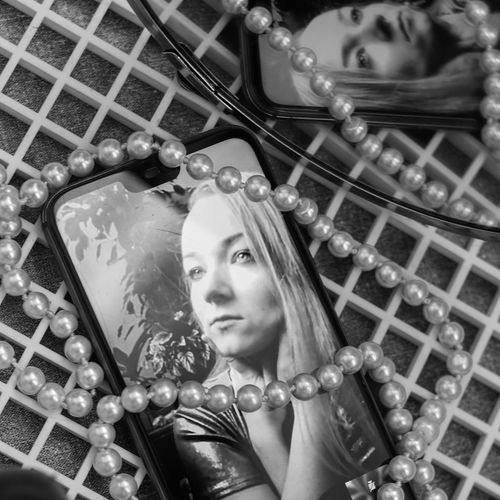 Young woman portrait durring facetime online photoshoot