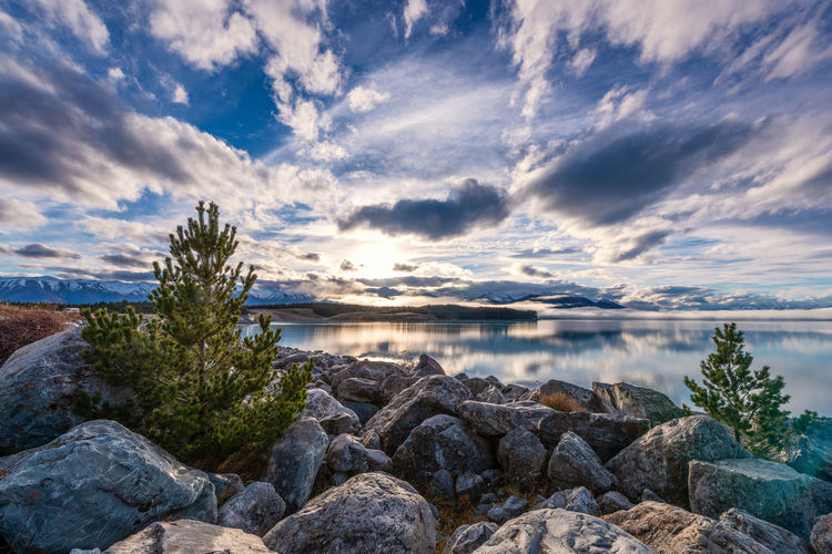 Reflections on the lake Reflection Beauty In Nature Cloud - Sky Idyllic Lake Land Nature No People Non-urban Scene Plant Rock Rock - Object Scenics - Nature Sea Sky Solid Sunset Tranquil Scene Tranquility Water
