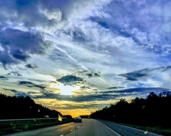 Driving On The Road Travel Traveling Looking Ahead Descending Cloudporn #skyporn #beautiful #bestskysever Illuminated Light Sunset_collection Sunset #sun #clouds #skylovers #sky #nature #beautifulinnature #naturalbeauty #photography #landscape Road Cloud - Sky Dramatic Sky Landscape Outdoors No People Scenics