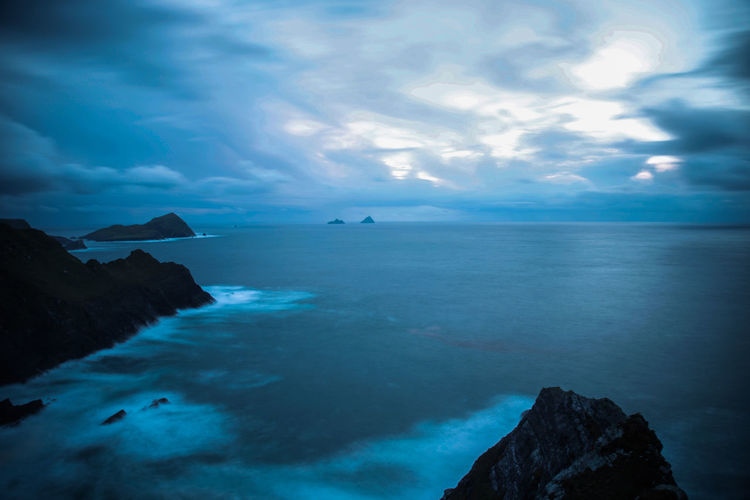 Beauty In Nature Blue Cliff Cloud - Sky Coastline Distant Horizon Over Water Ireland Kerry Cliffs Majestic Nature Non-urban Scene Outdoors Ring Of Kerry Rock - Object Rock Formation Scenics Sea Seascape Skellig Islands Sky Tourism Tranquil Scene Tranquility Water
