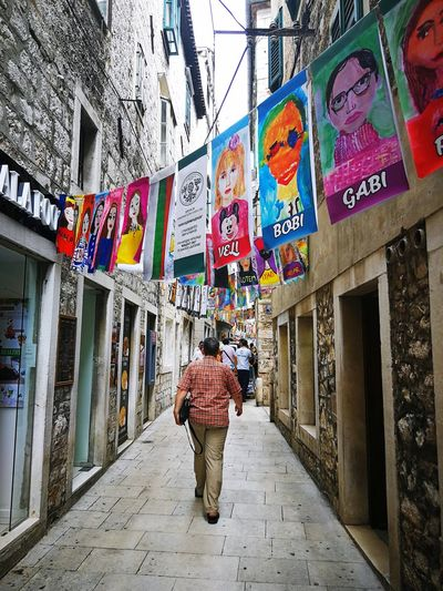 Kids art Sibenik Croatia Children's Art Painting Samokov Full Length Multi Colored Men City Walking Women Architecture Built Structure Building Exterior Street Art Walkway Pathway vanishing point The Street Photographer - 2018 EyeEm Awards #urbanana: The Urban Playground