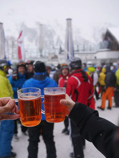 Jagertee at Apres-ski Alcohol Apres Ski ApresSki Après Beverage City Life Close-up Cropped Day Focus On Foreground Holding Jagertee Leisure Activity Lifestyles Men Outdoors Part Of Party Party Time Personal Perspective Refreshment Selective Focus Sky Tea Unrecognizable Person