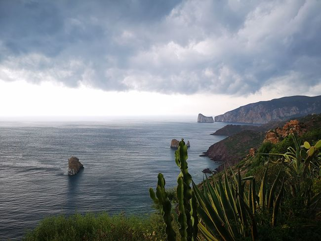 Water Sea Mountain Beach Sky Horizon Over Water Landscape Cloud - Sky Travel Rocky Coastline Idyllic Archipelago Rugged Seascape Rock Formation Stack Rock Remote Rushing Volcanic Rock Shore Natural Arch Island Foggy Ocean Physical Geography Geology Eroded Tide Tranquil Scene Scenics