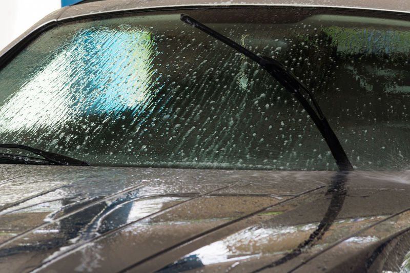 Manual car wash with pressurized water in the car wash outside. Motor Vehicle Car Mode Of Transportation Wet Water Transportation Rain Land Vehicle Glass - Material Windshield Drop No People Transparent Vehicle Interior Nature Close-up Cleaning Car Interior Rainy Season RainDrop