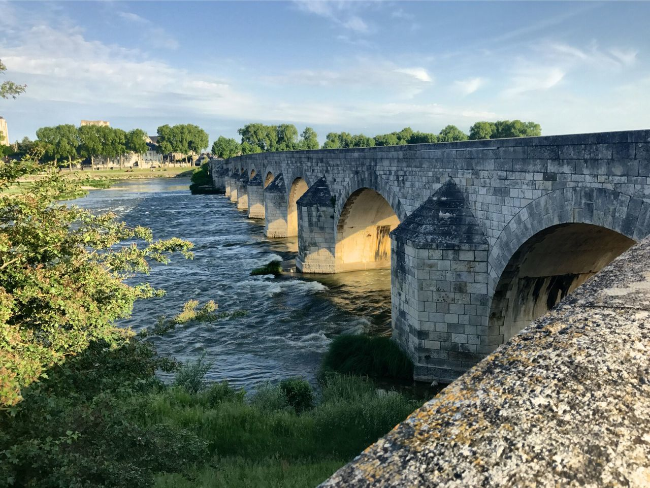 bridge - man made structure, connection, arch bridge, arch, architecture, viaduct, built structure, engineering, river, sky, outdoors, day, cloud - sky, water, transportation, no people, nature