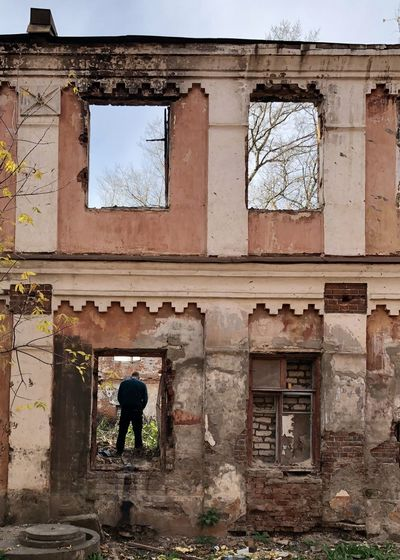 Rear view of man on old building