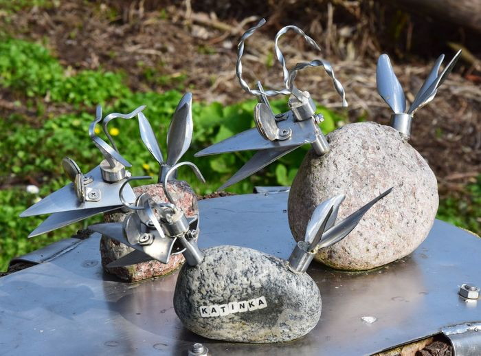 Nature Day No People Water Plant Metal Outdoors Focus On Foreground Close-up Solid Rock High Angle View Reflection Plant Part Rock - Object Equipment Leaf Sunlight Silver Colored Art And Craft Joke Birds